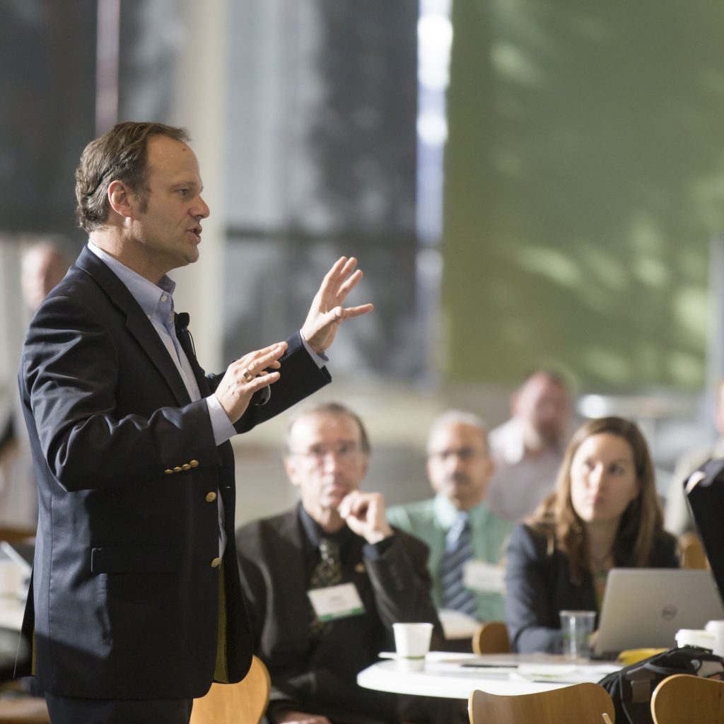 Man speaking at a conference