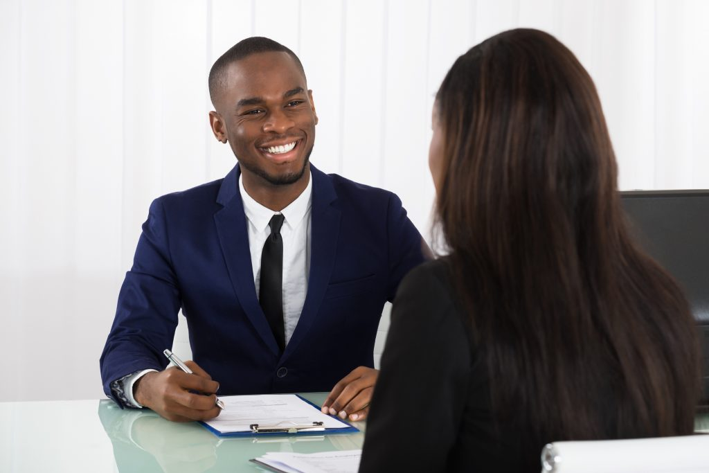 Man smiling at a woman during an interview