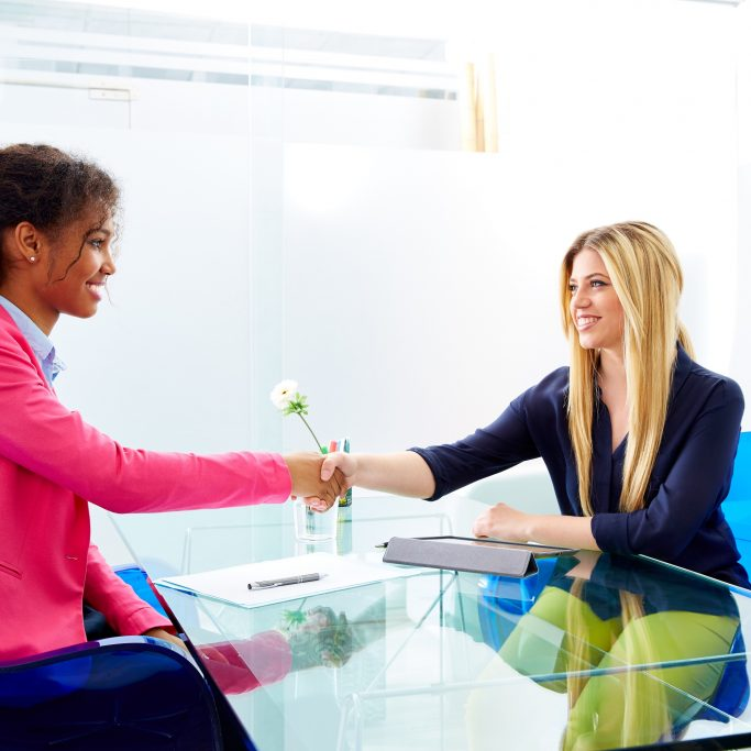 Women shaking hands after successful interview